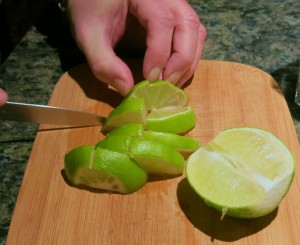 Cutting the limes into pieces.