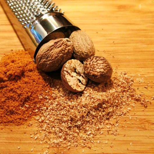 Whole Nutmeg and a Nutmeg Grater