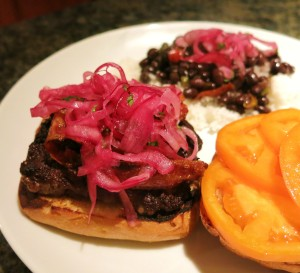 Peruvian Pickled Red Onion Salad on a Burger