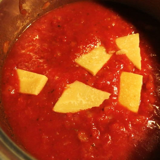 Parmesan Rinds added to Diced Onions and Fennel with Tomatoes