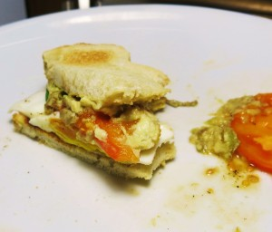 The Last Bites of an Avocado, Fried Egg and Tomato Sandwich