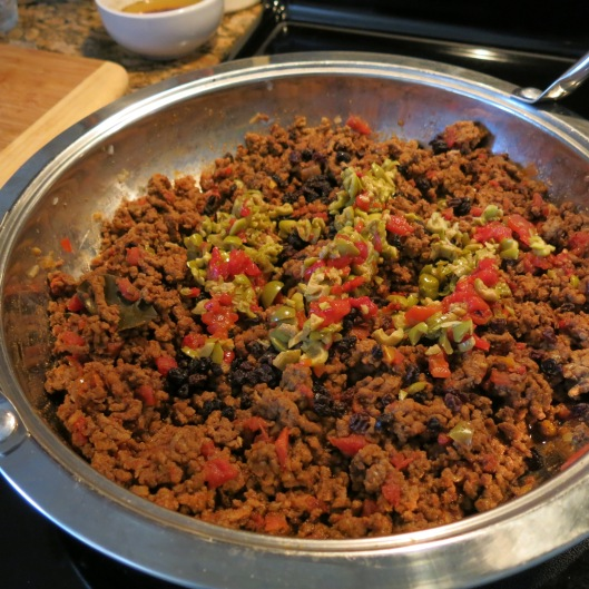 Picadillo with Stuffed Green Olives and Currants