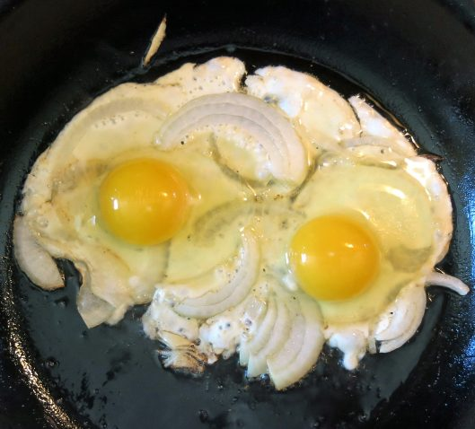 Eggs, Onions Slices Frying to Perfection