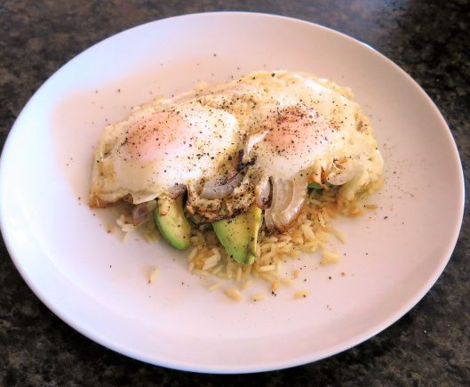 Fried Eggs with Avocado Slices over Garlic Rice