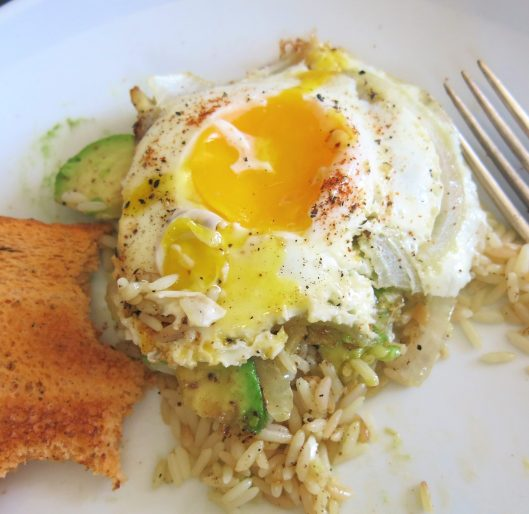 Fried Eggs and Avocados over Garlic Rice