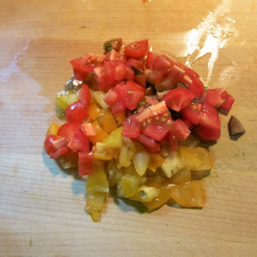 Diced red and yellow cherry tomatoes for Greek Salmon