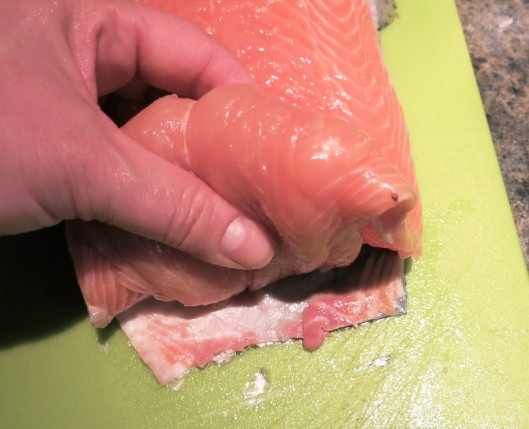 Evening out the thickness of a salmon filet.