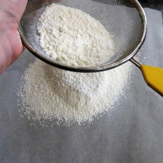 Sifting flour for Sponge Cake