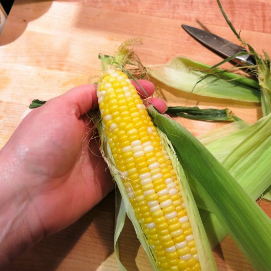Removing the Husks and Silk from Mircrowaved Sweet Corn