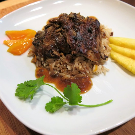 Island Spiced Pork Roast with Orange-Guava-Beer and Onion Sauce