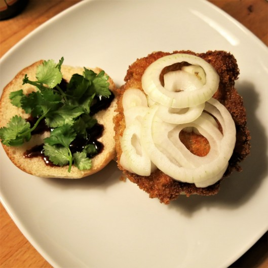 Breaded Pork Cutlet with Lemongrass-Garlic and Soy Marinade on a Bun with Toppings