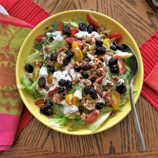 Salad Topped with Roasted Red Grapes with Blueberries